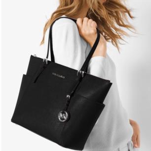 https://www.harrods.com/en-gb/michael-kors/jet-set-item-tote-bag-p000000000005356140?bcid=1467376676469&colour=black